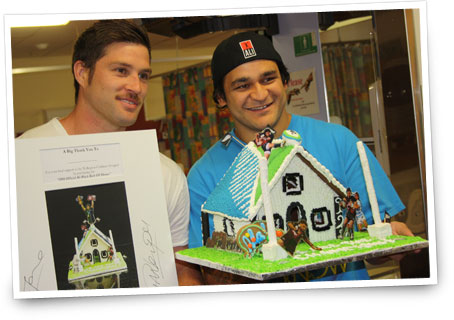 Cory Jane and Pirir Weepu with a rugby inspired Gingerbread House